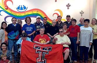 Group Photo at L'Arche, Jacksonville, Florida, with Texas Tech Flag